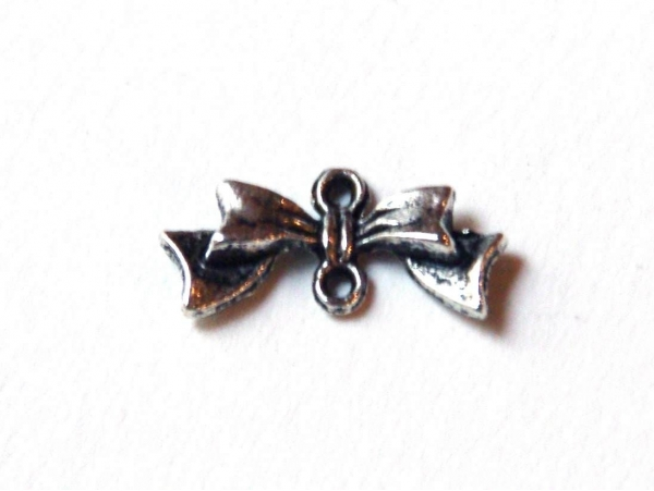 1 elongated bow charm - silver-coloured