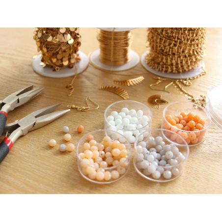Acheter Lot de 50 perles à facettes en verre 4x6 mm - beige - 1,59€ en ligne sur La Petite Epicerie - Loisirs créatifs