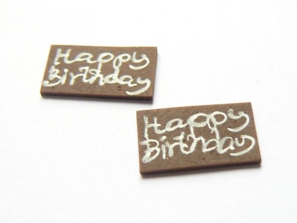 "1 ""Happy Holiday"" chocolate decoration"