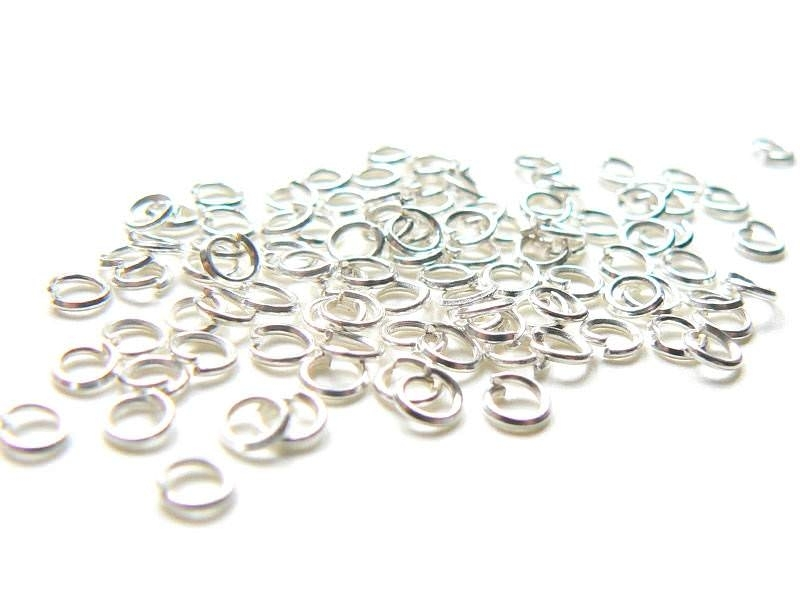 100 light silver-coloured jump rings, 3 mm