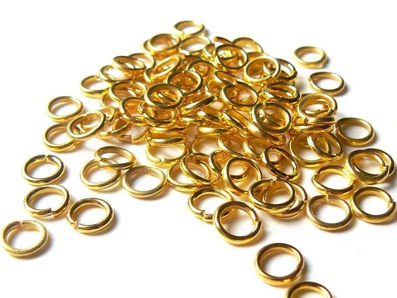 100 anneaux 6 mm dorés  - 1
