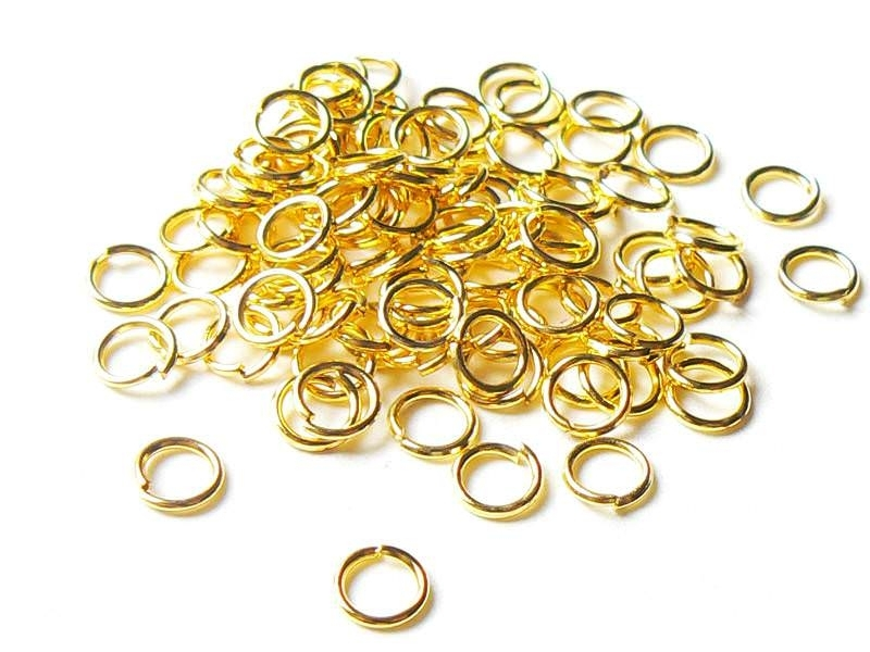 100 gold-coloured jump rings, 5 mm