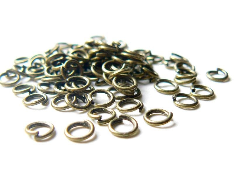 Acheter 100 anneaux 5 mm couleur bronze - 2,99€ en ligne sur La Petite Epicerie - Loisirs créatifs