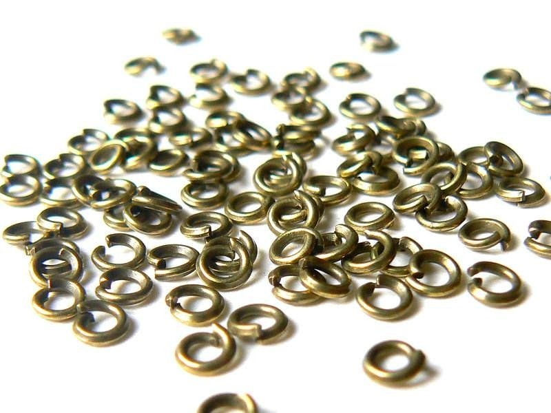 100 bronze-coloured jump rings, 3 mm