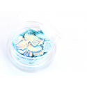 Petit pot de paillettes en forme de coquillages bleus irisés