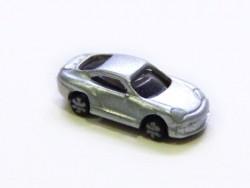 1 small metallic grey car