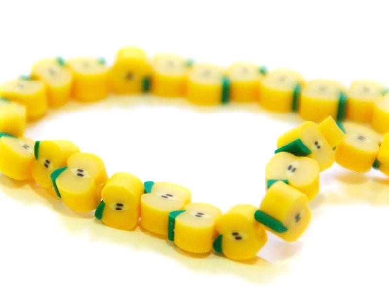 20 yellow apple beads