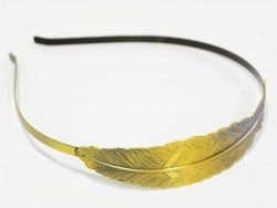 Bronze-coloured Alice band with a feather