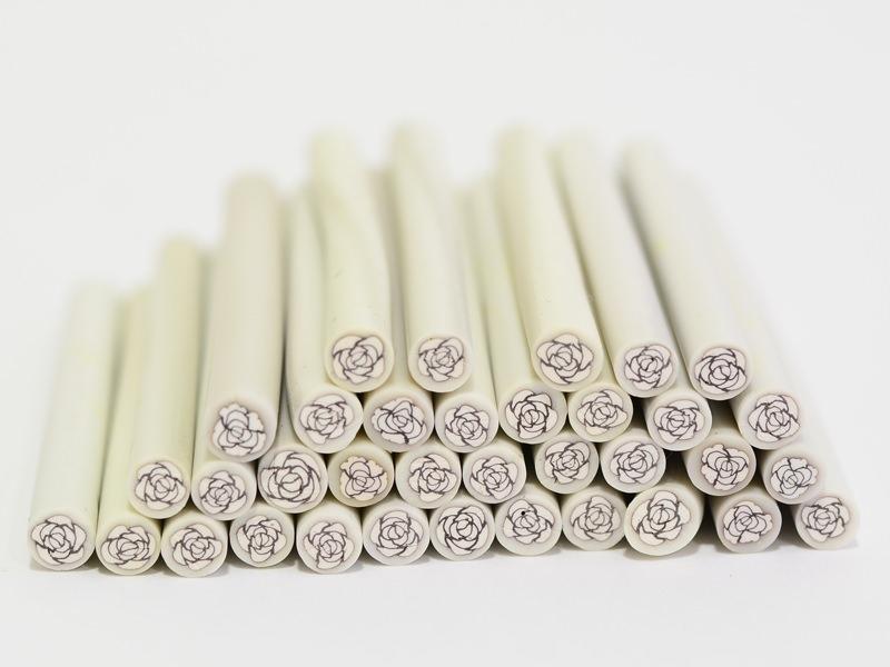Acheter Cane rose blanche en pâte fimo - modelage - 0,99€ en ligne sur La Petite Epicerie - 100% Loisirs créatifs