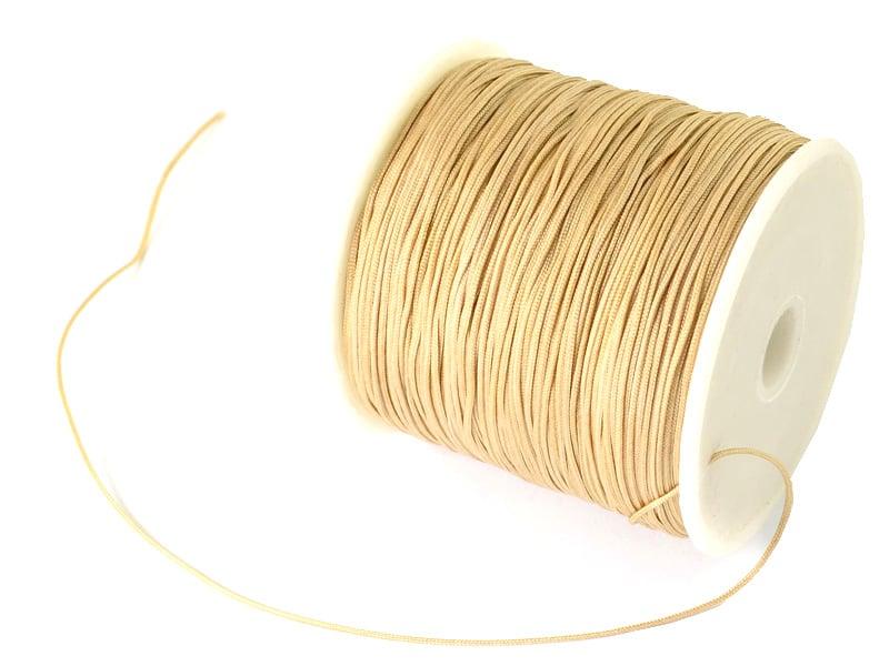 Acheter 1 m de fil de jade / fil nylon tressé 0,5 mm - beige - 0,39€ en ligne sur La Petite Epicerie - Loisirs créatifs