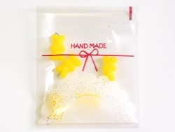 "1 plastic bag with adhesive seal - ""Handmade"""