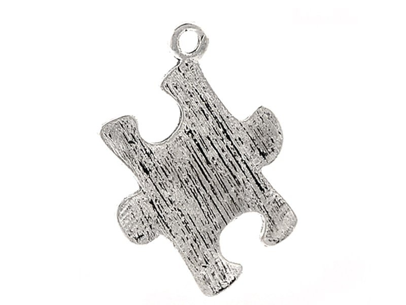 1 jigsaw piece charm - silver-coloured