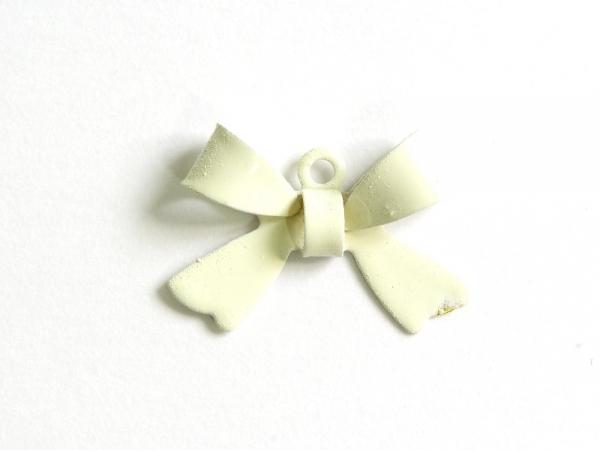 1 white bow charm