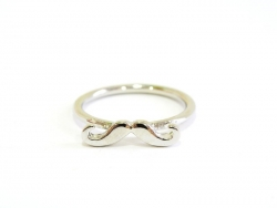 A silver-coloured moustache ring